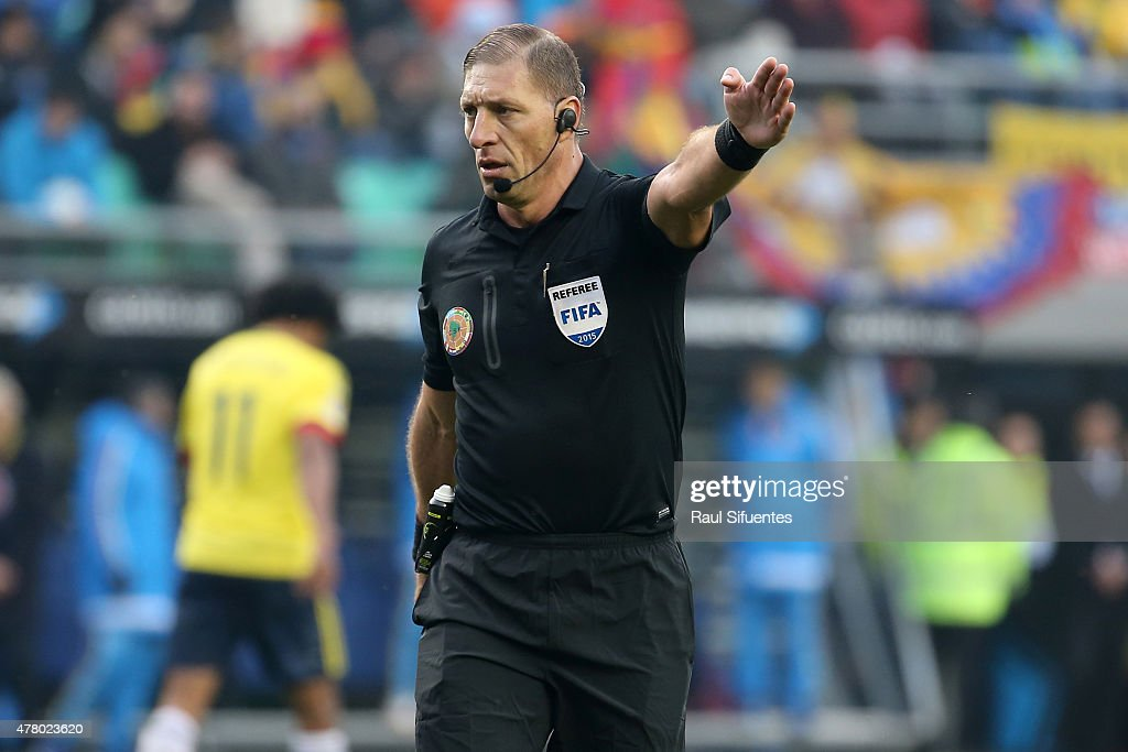 Referee Nestor Pitana gives direction during the 2015 Copa America Chile Group C match between Colombia and Peru at Municipal Bicentenario Germán Becker Stadium on June 21, 2015 in Temuco, Chile.