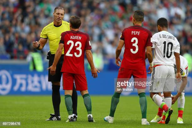 Referee Nestor Pitana speaks to Adrien Silva of Portugal during the FIFA Confederations Cup Russia 2017 Group A match between Portugal and Mexico at...