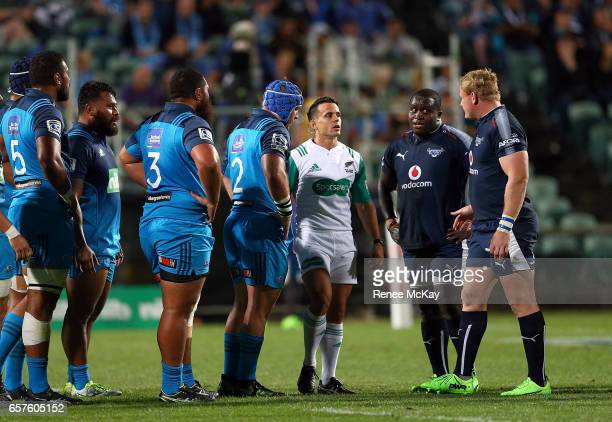 Referee Nick Berry talks with the front rows during the round five Super Rugby match between the Blues and the Bulls at Eden Park on March 25 2017 in...