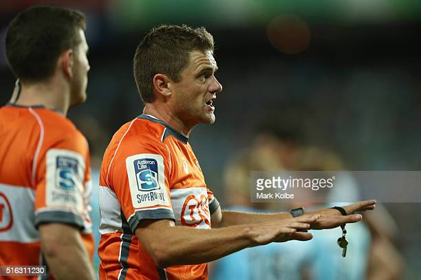 Referee Nick Briant calls for a video referee decision during the Super Rugby match between the New South Wales Waratahs and the Highlanders at...