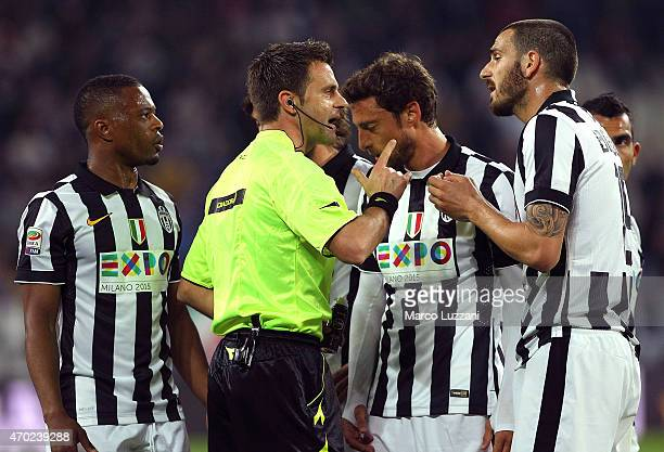 Referee Nicola Rizzoli disputes with Leonardo Bonucci of Juventus FC during the Serie A match between Juventus FC and SS Lazio at Juventus Arena on...