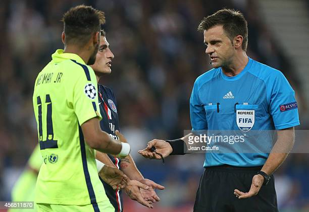 Referee Nicola Rizzoli explains his decision during the UEFA Champions League Group F match between Paris SaintGermain FC and FC Barcelona at the...