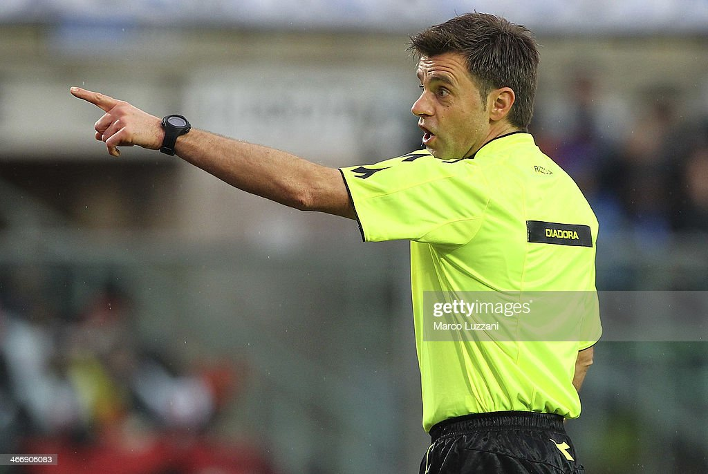 Referee <a gi-track='captionPersonalityLinkClicked' href=/galleries/search?phrase=Nicola+Rizzoli&family=editorial&specificpeople=4238940 ng-click='$event.stopPropagation()'>Nicola Rizzoli</a> gestures during the Serie A match between Atalanta BC and SSC Napoli at Stadio Atleti Azzurri d'Italia on February 2, 2014 in Bergamo, Italy.