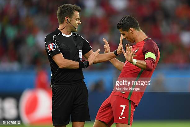 Referee Nicola Rizzoli in conversation with Cristiano Ronaldo of Portugal during the UEFA EURO 2016 Group F match between Portugal and Austria at...