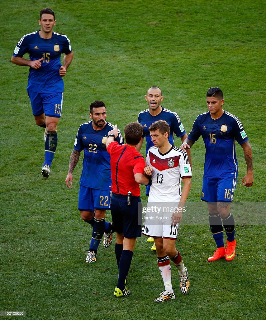 Referee Nicola Rizzoli intervenes as Thomas Mueller of Germany clashes with Ezequiel Lavezzi, Pablo Zabaleta and Marcos Rojo of Argentina during the 2014 FIFA World Cup Brazil Final match between Germany and Argentina at Maracana on July 13, 2014 in Rio de Janeiro, Brazil.