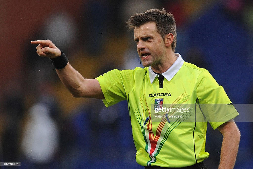 Referee Nicola Rizzoli points during the Serie A match between Genoa CFC and Calcio Catania at Stadio Luigi Ferraris on January 20, 2013 in Genoa, Italy.
