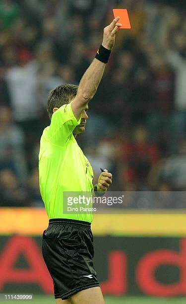 Referee Nicola Rizzoli shows a red card to Cristian Chivu of Inter during the Serie A match between AC Milan and FC Internazionale Milano at Stadio...