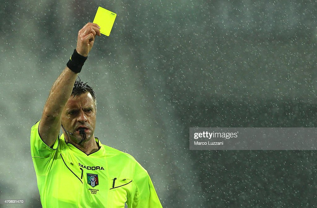 Referee Nicola Rizzoli shows the yellow card during the Serie A match between Juventus FC and SS Lazio at Juventus Arena on April 18 2015 in Turin...