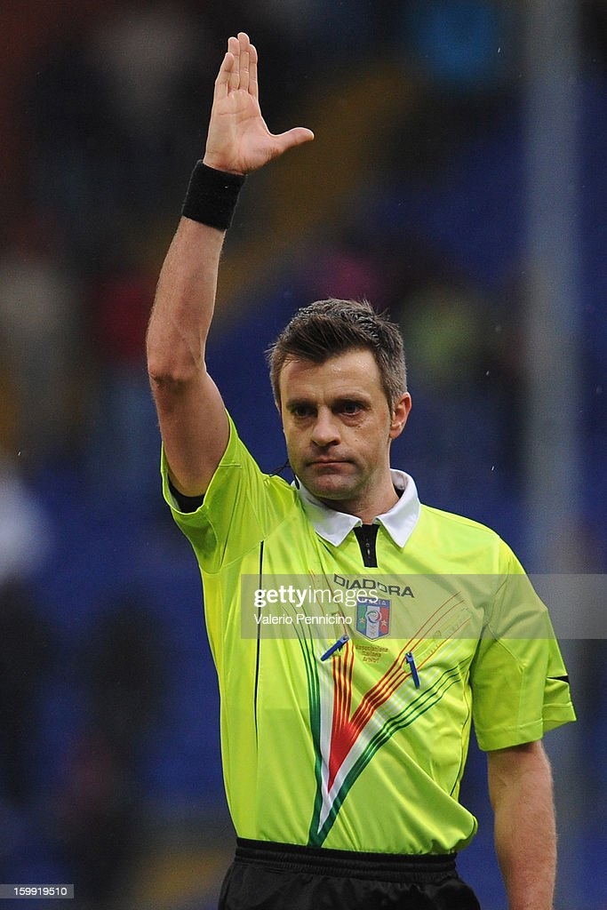 Referee <a gi-track='captionPersonalityLinkClicked' href=/galleries/search?phrase=Nicola+Rizzoli&family=editorial&specificpeople=4238940 ng-click='$event.stopPropagation()'>Nicola Rizzoli</a> signals a foul during the Serie A match between Genoa CFC and Calcio Catania at Stadio Luigi Ferraris on January 20, 2013 in Genoa, Italy.
