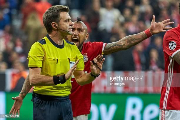 Referee Nicola Rizzoli speak with Arturo Vidal of Munich during the UEFA Champions League Quarter Final first leg match between FC Bayern Muenchen...
