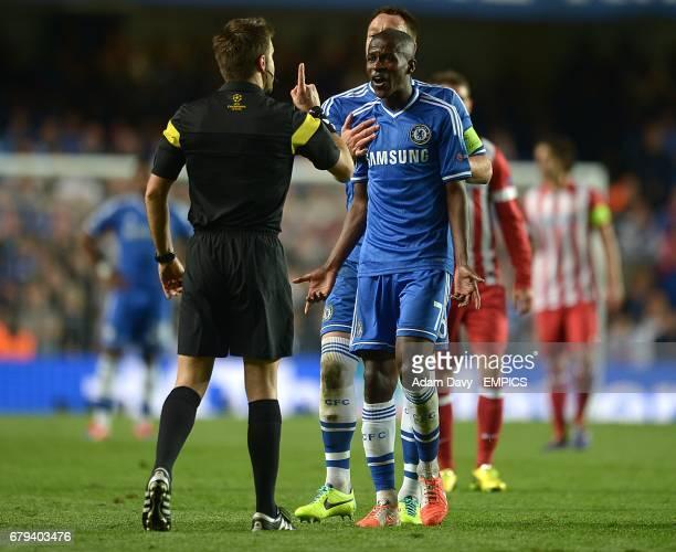 Referee Nicola Rizzoli speaks with Chelsea's Nascimento Ramires