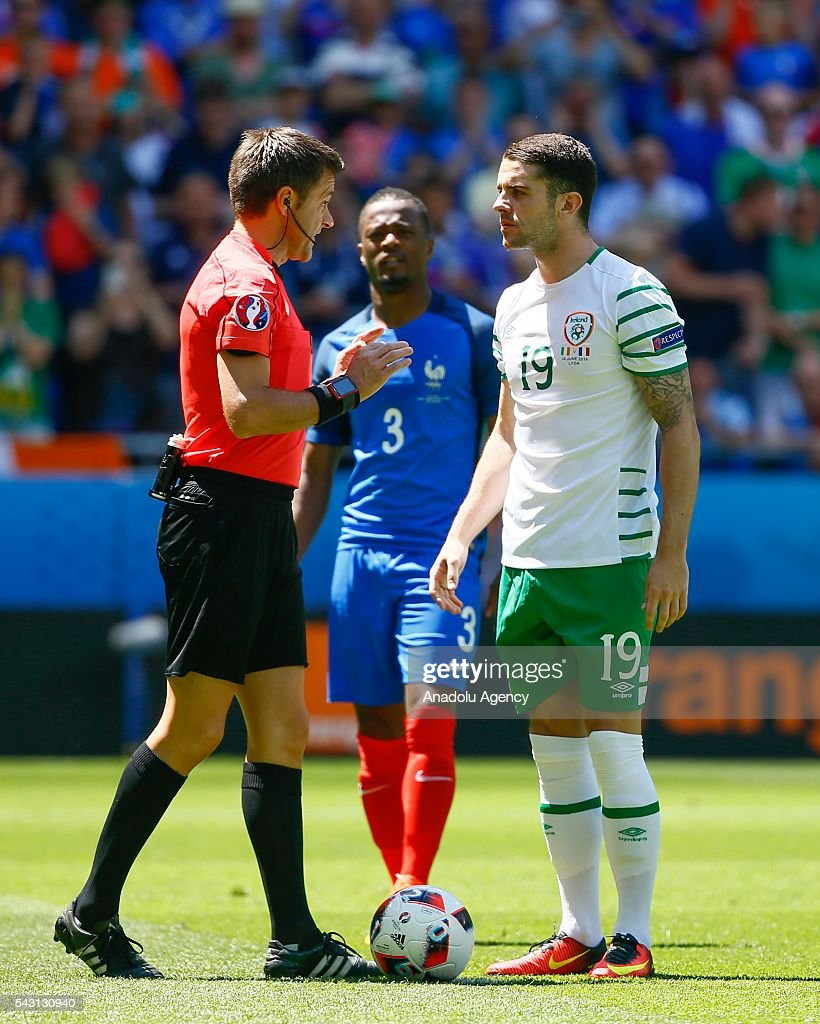 Referee Nicola Rizzoli speaks with Robbie Brady of Ireland during the UEFA Euro 2016 Round of 16 football match between France and Ireland at the Stade de Lyon in Lyon, France on June 26, 2016.