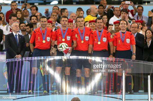 Referee Nicola Rizzoli with his assistants collect their medals after the game