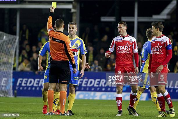 referee Nicolas Laforge gives Filip Daems defender of KVC Westerlo a yellow card during the Jupiler Pro League match between Royal Excel Mouscron and...