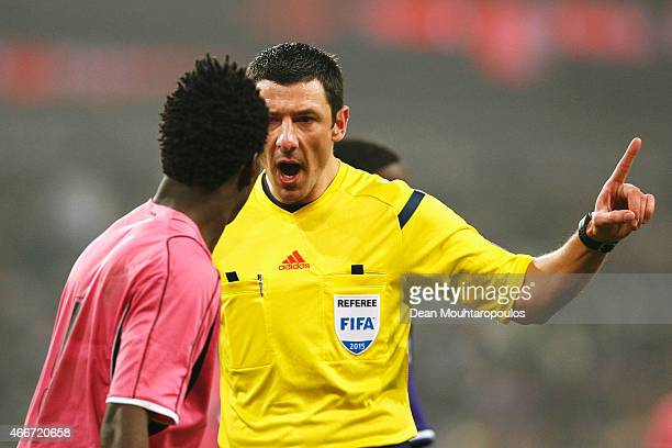 Referee Nicolas Rainville of France has a firm word with Lumor Agbenyenu of Porto during the UEFA Youth League quarter final match between RSC...