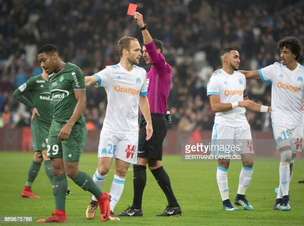 Referee Nicolas Rainville shows a red card to SaintEtienne's French defender Ronael PierreGabriel next to Marseille's French forward Valere Germain...