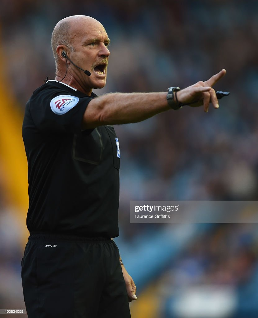 Referee Nigel Miller in action during the Sky Bet Championship match between Sheffield Wednesday and Millwall at Hillsborough Stadium on August 19, 2014 in Sheffield, England.