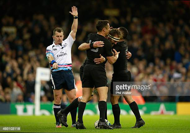 Referee Nigel Owens awards the try scored by Kieran Read of the New Zealand All Blacks during the 2015 Rugby World Cup Quarter Final match between...