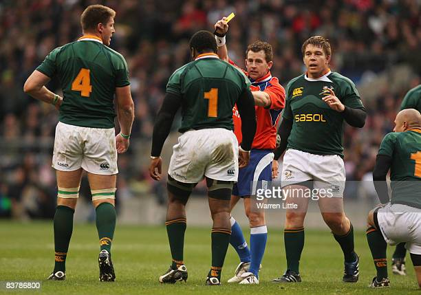 Referee Nigel Owens awards the yellow card to Tendai Mtawarira of South Africa during the Investec Challenge match between England and South Africa...