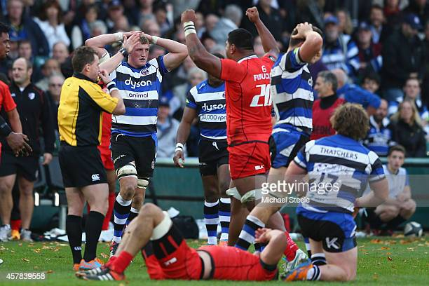 Referee Nigel Owens blows the final whistle as Stuart Hooper the captain of Bath looks dejected after his sides 1921 defeat during the European Rugby...