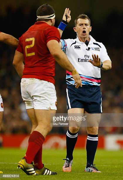 Referee Nigel Owens calls a decision during the 2015 Rugby World Cup Quarter Final match between New Zealand and France at Millennium Stadium on...