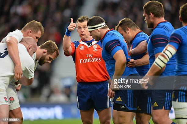Referee Nigel Owens gestures during the Six Nations international rugby union match between England and France at Twickenham Stadium south west of...