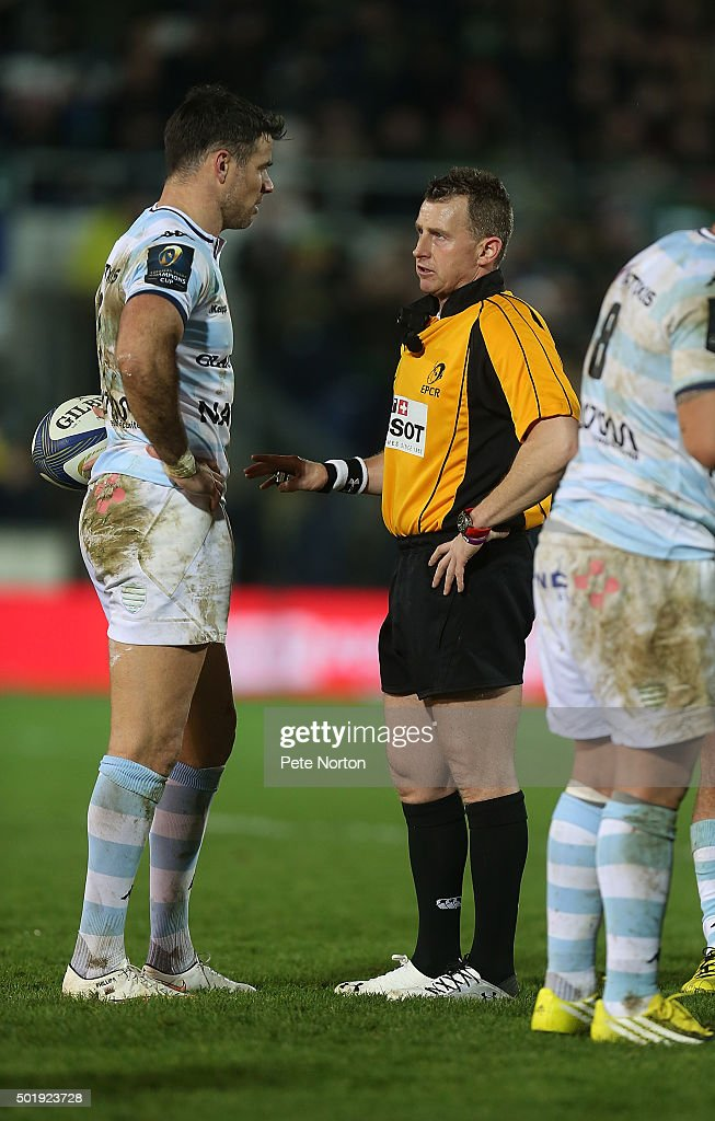 Referee <a gi-track='captionPersonalityLinkClicked' href=/galleries/search?phrase=Nigel+Owens&family=editorial&specificpeople=2123896 ng-click='$event.stopPropagation()'>Nigel Owens</a> makes a point to Mike Phillips of Racing 92 during the European Rugby Champions Cup match between Northampton Saints and Racing 92 at Franklin's Gardens on December 18, 2015 in Northampton, England.