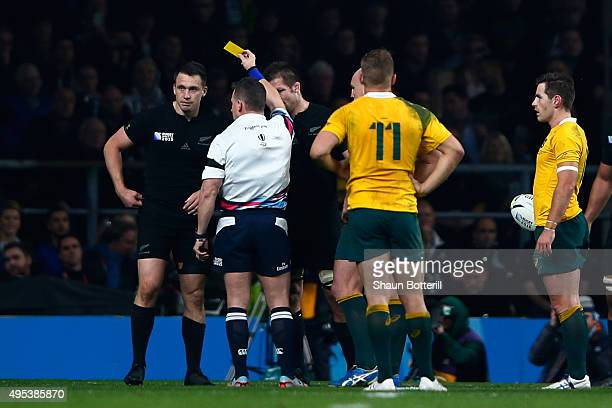 Referee Nigel Owens of Wales shows the yellow card to Ben Smith of New Zealand during the 2015 Rugby World Cup Final match between New Zealand and...