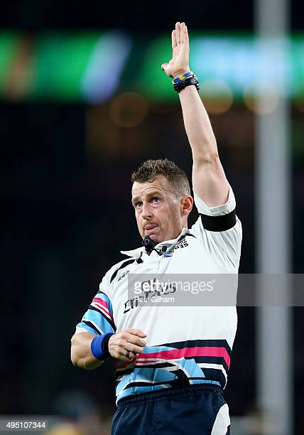Referee Nigel Owens of Wales signals a drop goal scored by Dan Carter of New Zealand during the 2015 Rugby World Cup Final match between New Zealand...