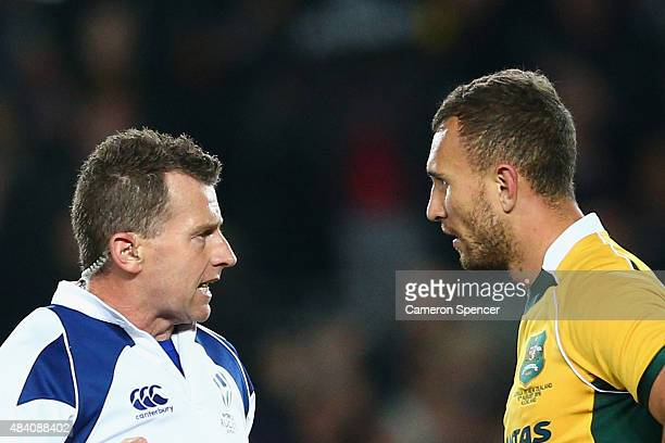 Referee Nigel Owens sends off Quade Cooper of the Wallabies with a yellow card during The Rugby Championship Bledisloe Cup match between the New...