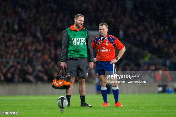 Referee Nigel Owens shares a joke with New Zealand's Kieran Read on water boy duty during the Killik Cup match between Barbarians and New Zealand at...