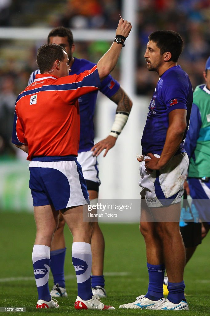 Referee <a gi-track='captionPersonalityLinkClicked' href=/galleries/search?phrase=Nigel+Owens&family=editorial&specificpeople=2123896 ng-click='$event.stopPropagation()'>Nigel Owens</a> show <a gi-track='captionPersonalityLinkClicked' href=/galleries/search?phrase=Paul+Williams+-+Rugby&family=editorial&specificpeople=4663745 ng-click='$event.stopPropagation()'>Paul Williams</a> of Samoa a red card during the IRB 2011 Rugby World Cup Pool D match between South Africa and Samoa at North Harbour Stadium on September 30, 2011 in Auckland, New Zealand.