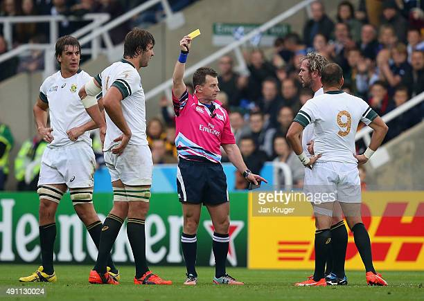Referee Nigel Owens shows Jannie Du Plessis of South Africa a yellow card during the 2015 Rugby World Cup Pool B match between South Africa and...