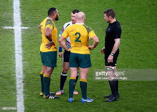 Referee Nigel Owens talks with both captains Richie McCaw of the New Zealand All Blacks and Stephen Moore of Australia as well as Sekope Kepu during...