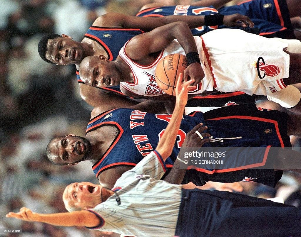 Referee Nolan Fine (L) ejects New York Knicks forward Charles Oakley (2nd L) for fighting as Miami Heat guard Tim Hardaway (2nd R) and Knicks center Patrick Ewing (R) watch in the fourth period 14 May of their Eastern Conference Semifinals playoff game at the Miami Arena. Oakley, as well as teammates John Starks and Charlie Ward and Heat forward P.J. Brown, were ejected for fighting. The Heat won 96-81 but the Knicks retain the lead in the best-of-seven series 3-2.