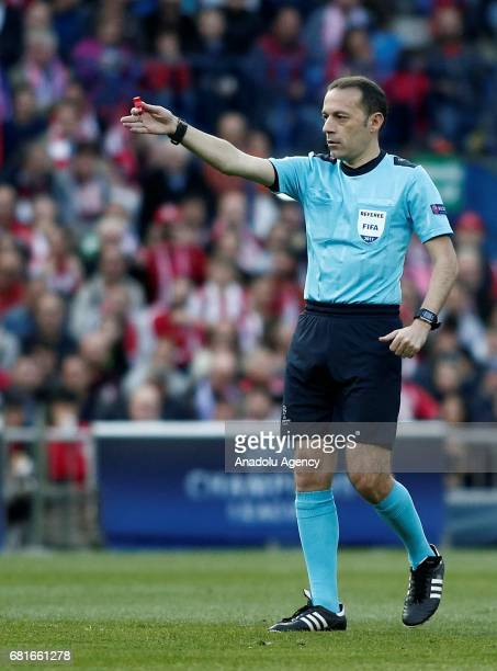 Referee of the match Cuneyt Cakir gestures during the UEFA Champions League semi final second leg match between Atletico Madrid and Real Madrid at...