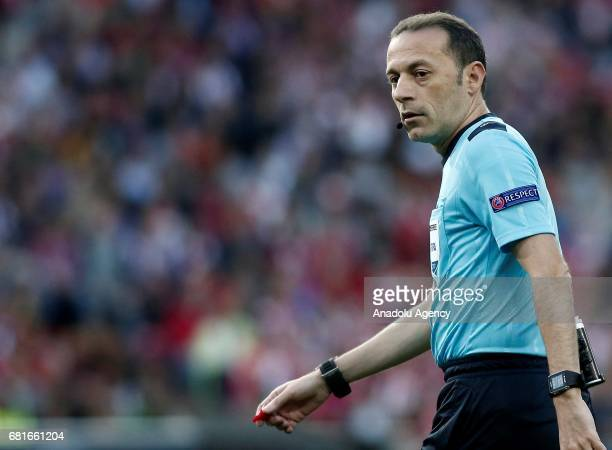 Referee of the match Cuneyt Cakir is seen during the UEFA Champions League semi final second leg match between Atletico Madrid and Real Madrid at...