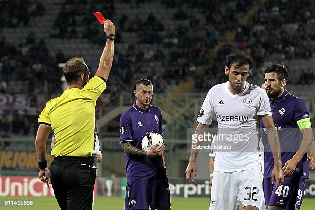 Referee Oliver Drachta shows the red card to Elvin Yunuszadä of Qarabag FK during the UEFA Europa League match between ACF Fiorentina and Qarabag FK...