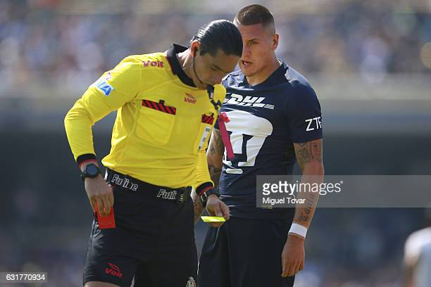 Referee Oscar Romo shows the red card to Nicolas Castillo of Pumas during the 2nd round match between Pumas UNAM and Cruz Azul as part of the Torneo...