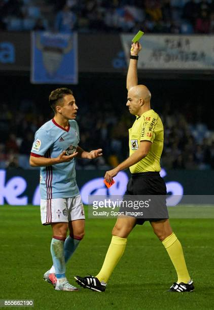 Referee Pablo Gonzalez Fuertes shows yellow card to Emre Mor of Celta de Vigo during the La Liga match between Celta de Vigo and Girona at Balaidos...