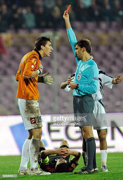 Referee Paolo Tagliavento gives a red card to goalkeeper Costel Pantilimon of FC Timisoara during UEFA Europa League group A football match against...
