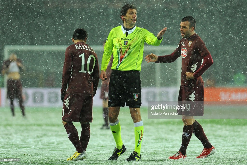 Referee Paolo Tagliavento (C) reacts during the Serie A match between Torino FC and S.S. Lazio at Stadio Olimpico di Torino on March 17, 2013 in Turin, Italy.