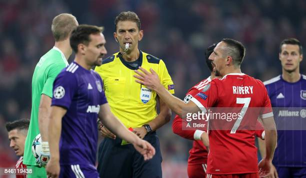 Referee Paolo Tagliavento shows the yellow card to Franck Ribery of Muenchen during the UEFA Champions League group B match between Bayern Muenchen...