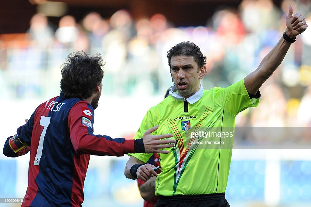 Referee Paolo Tagliavento signals a foul during the Serie A match between Genoa CFC and SS Lazio at Stadio Luigi Ferraris on February 3, 2013 in Genoa, Italy.