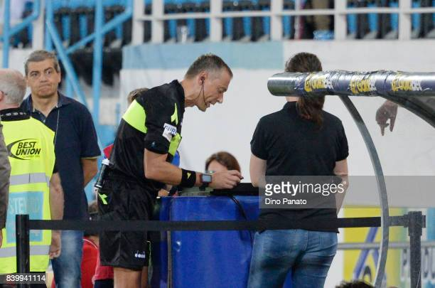 Referee Paolo Valeri consult the VAR during the Serie A match between Spal and Udinese Calcio at Stadio Paolo Mazza on August 27 2017 in Ferrara Italy