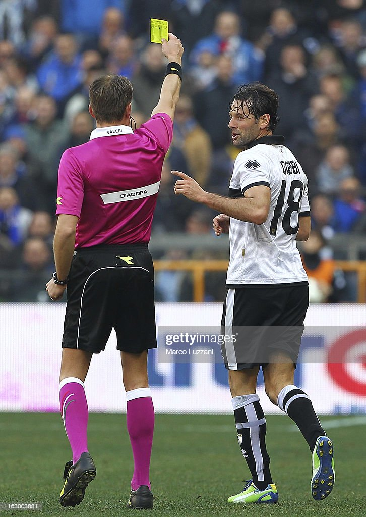 Referee Paolo Valeri shows the yellow card to Massimo Gobbi of Parma FC during the Serie A match between UC Sampdoria and Parma FC at Stadio Luigi Ferraris on March 3, 2013 in Genoa, Italy.
