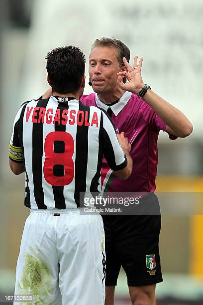 Referee Paolo Valeri speaks with Simone Vergassola of AC Siena during the Serie A match between AC Siena and AC Chievo Verona at Stadio Artemio...