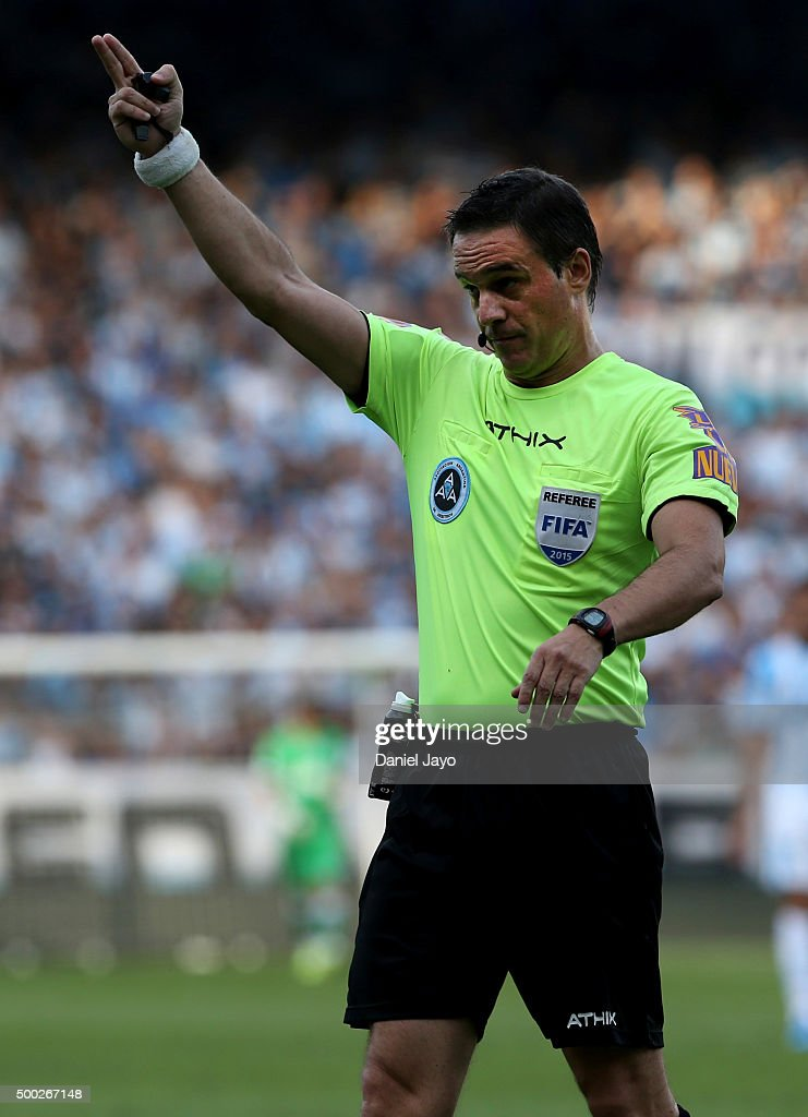 Referee <a gi-track='captionPersonalityLinkClicked' href=/galleries/search?phrase=Patricio+Loustau&family=editorial&specificpeople=7946692 ng-click='$event.stopPropagation()'>Patricio Loustau</a> gestures during a second leg match between Independiente and Racing Club as part of Pre Copa Libertadores Playoff at Presidente Peron Stadium on December 06, 2015 in Avellaneda, Argentina.