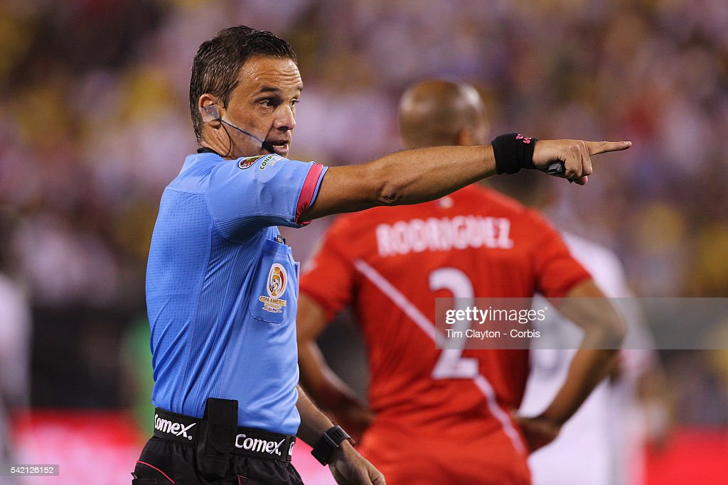 Referee <a gi-track='captionPersonalityLinkClicked' href=/galleries/search?phrase=Patricio+Loustau&family=editorial&specificpeople=7946692 ng-click='$event.stopPropagation()'>Patricio Loustau</a> of Argentina in action during the Colombia Vs Peru Quarterfinal match of the Copa America Centenario USA 2016 Tournament at MetLife Stadium on June 17, 2016 in East Rutherford, New Jersey.