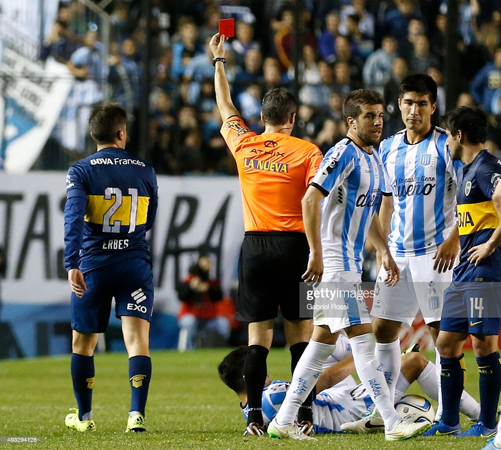 Referee <a gi-track='captionPersonalityLinkClicked' href=/galleries/search?phrase=Patricio+Loustau&family=editorial&specificpeople=7946692 ng-click='$event.stopPropagation()'>Patricio Loustau</a> shows a red card to Cristian Erbes of Boca Juniors during a match between Racing Club and Boca Juniors as part of round 28 of Torneo de Primera Division at Presidente Peron Stadium on October 18, 2015 in Avellaneda, Argentina.